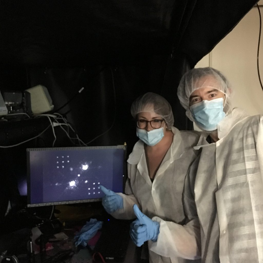 Jared and Kelsey pose with an image taken through the vAPP coronagraph.